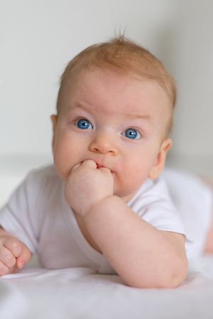 Four months old baby with blue eyes Stock Photo