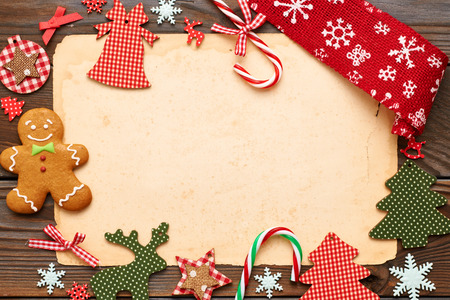 table set: Christmas homemade gingerbread cookie and handmade decoration on wooden background Stock Photo