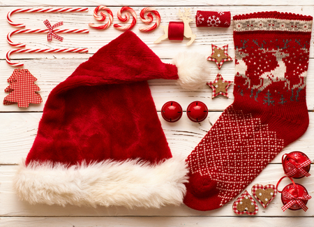 stocking cap: Christmas decoration on wooden background flat lay still life Stock Photo