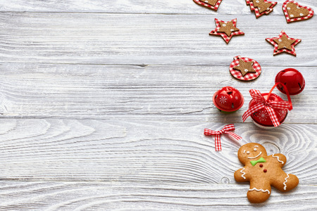 winter wood: Christmas homemade gingerbread cookies and decoration on wooden background