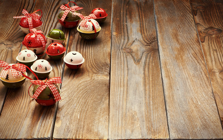 Christmas jingle bells decoration on wooden background Stock Photo