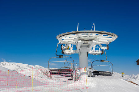 france station: Ski lift station in mountains at winter. Alpine winter mountain landscape. French Alps covered with snow in sunny day. Val-dIsere, Alps, France Stock Photo