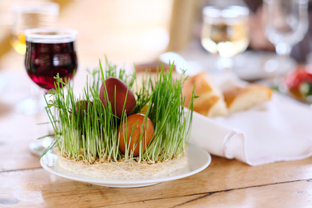 Easter table setting with eggs, wine and decoration Stock Photo