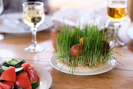 table decoration: Easter table setting with eggs, wine and decoration Stock Photo
