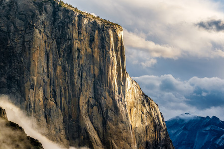 granite park: El Capitan rock close-up in Yosemite National Park Valley at cloudy autumn morning from Tunnel View. Low clouds lay in the valley. California, USA. Stock Photo