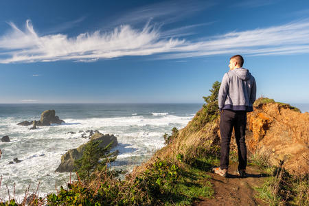 Lone man at USA Pacific coast landscape, Oregon State