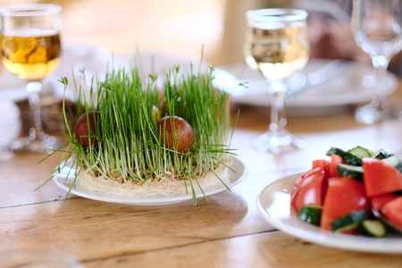 holiday tradition: Easter table setting with eggs, wine and decoration Stock Photo