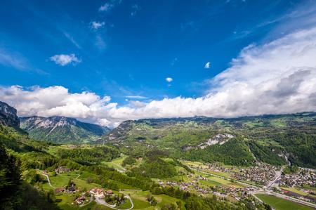 Swiss village in valley under low clouds near Reichenbach, Switzerland