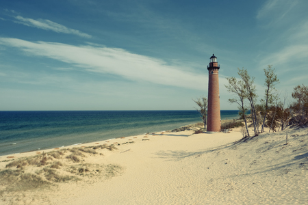 lake michigan lighthouse: Little Sable Point Lighthouse in dunes, built in 1867, Lake Michigan, MI, USA