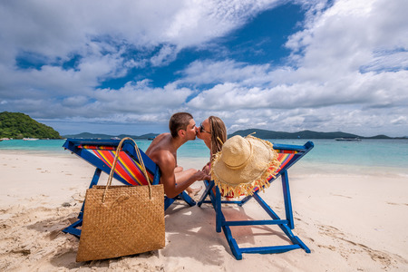 beachbag: Couple kissing on tropical beach in loungers at Thailand