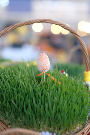 holiday tradition: Easter baskets with grass at market Stock Photo
