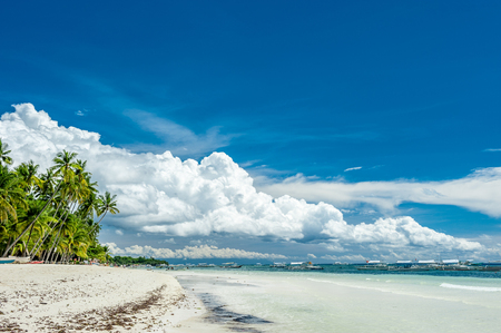 Alona tropical beach with palm trees at Panglao, Philippines