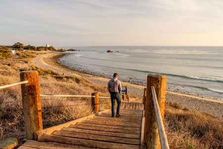 Man walking at boardwalk to Leo Carrillo State Beach, Malibu, California. Stock Photo