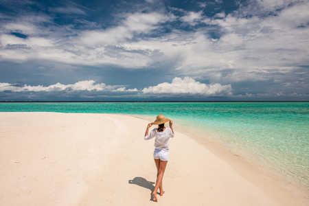 sunhat: Woman with sun hat on tropical beach at Maldives Stock Photo