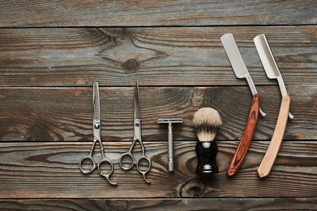 scissors: Vintage barber shop tools on old wooden background