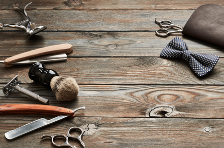 Vintage barber shop tools on old wooden background Stock fotó - 76161815
