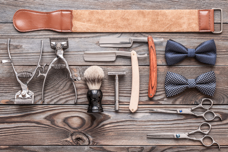 Vintage barber shop tools on old wooden background
