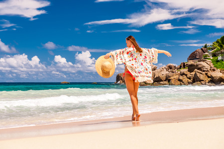 Woman with sarong on beach Anse Intendance at Seychelles, Mahe Stock Photo