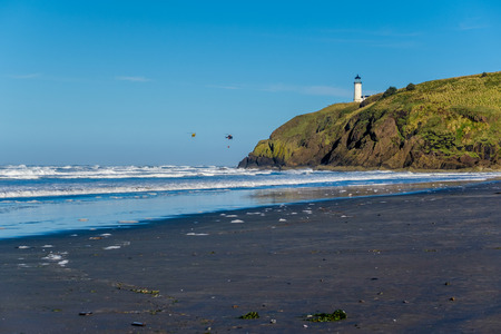 North Head Lighthouse at Pacific coast, Cape Disappointment, built in 1898, WA, USA. Coast guard helicopters in the sky. Stock Photo