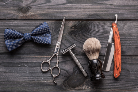 Vintage barber shop tools on old wooden background Фото со стока - 77237328
