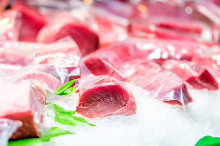 Fresh tuna fish on cooled market display