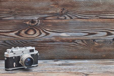 rangefinder: Vintage old retro 35mm rangefinder camera on wooden background with copy space