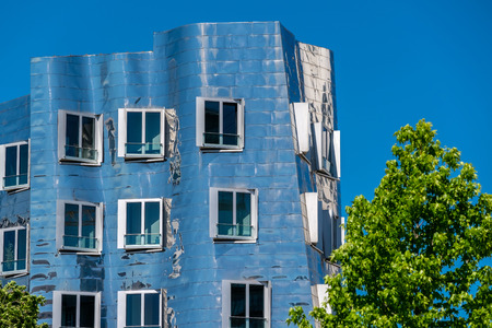 Closeup view of Frank Gehrys famous modern building at Neuer Zollhof in Dusseldorf, Germany.