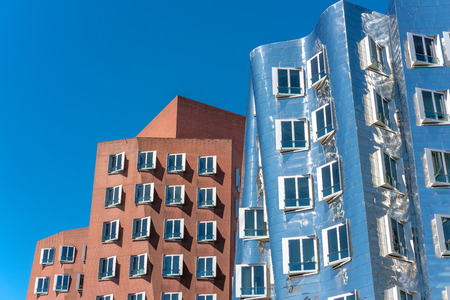 Closeup view of Frank Gehrys famous modern buildings at Neuer Zollhof in Dusseldorf, Germany. Stock Photo