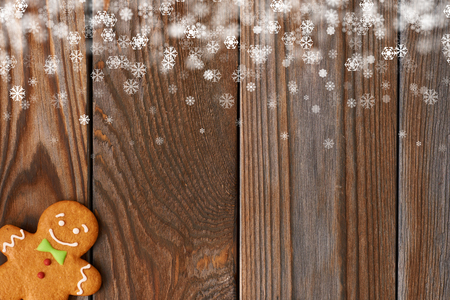 Christmas homemade gingerbread man cookie on wooden background Stock Photo