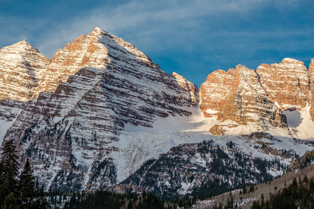Maroon Bells mountains in snow at morning in Colorado, USA.