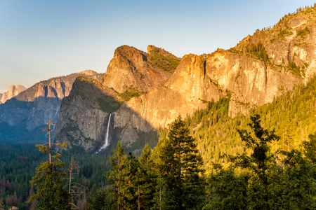 bridalveil fall: Yosemite National Park Valley summer landscape with Bridalveil Fall from Tunnel View. California, USA. Stock Photo