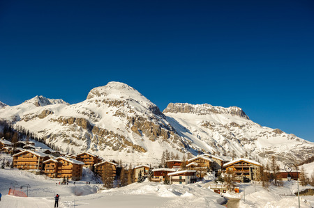 Alpine winter mountain landscape. French Alps covered with snow in sunny day. Val-dIsere, France Stock Photo