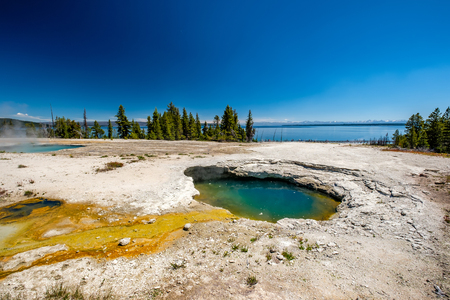 Hot thermal spring in Yellowstone National Park, West Thumb Geyser Basin area, Wyoming, USA Reklamní fotografie