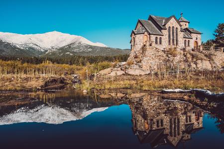 Chapel on the Rock, Church of Saint Malo near Estes Park. Season changing from autumn to winter. Rocky Mountains, Colorado, USA.  Stock Photo
