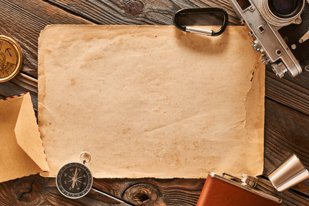 Vintage old 35mm camera on wooden background with old blank paper sheet Stok Fotoğraf