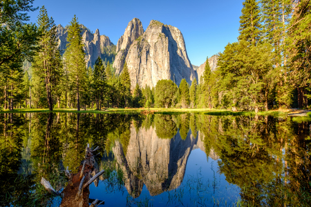Middle Cathedral Rock reflecting in Merced River at Yosemite National Park. California, USA.