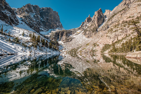 Emerald Lake and reflection with rocks and mountains in snow around at autumn. Rocky Mountain National Park in Colorado, USA. Stock Photo - 97001875