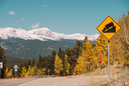 Steep grade truck road sign on highway at autumn sunny day in Colorado, USA. 스톡 콘텐츠