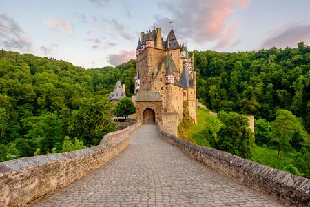 Burg Eltz castle in Rhineland-Palatinate state at sunset, Germany. Construction startedprior to 1157.