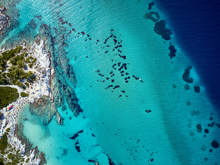 Beautiful beach and rocky coastline top aerial view drone shot, Sithonia, Greece