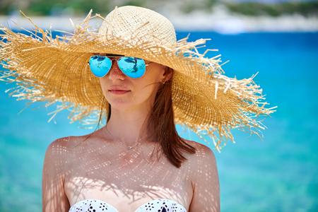 Woman in bikini on beach, Sithonia, Greece Imagens