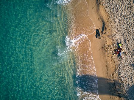 Beautiful beach with family top aerial view drone shot, Sithonia, Greece Stock fotó