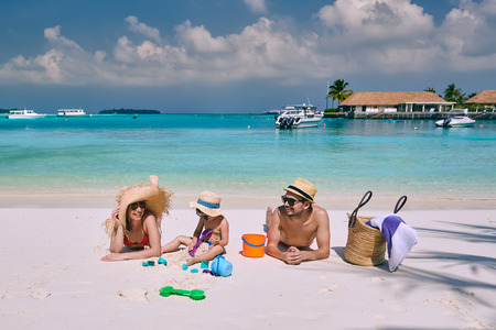 Family on beach, young couple with three year old boy. Summer vacation at Maldives.