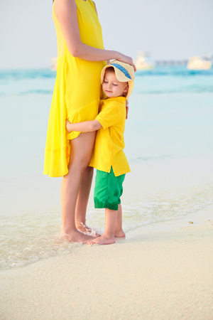 Three year old toddler boy on beach with mother. Summer family vacation at Maldives.