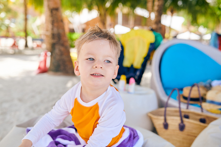 Three year old toddler boy on beach. Summer family vacation at Maldives.
