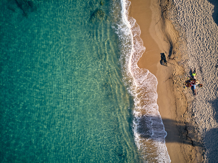 Beautiful beach with family top aerial view drone shot, Sithonia, Greece Stock Photo