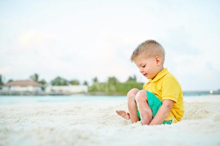 Three year old toddler boy on beach. Summer family vacation at Maldives.