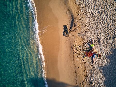 Beautiful beach with family top aerial view drone shot, Sithonia, Greece Banco de Imagens