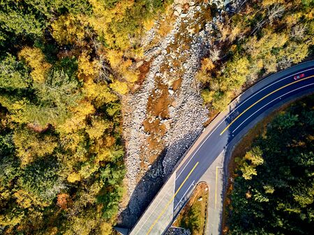 Scenic Mohawk Trail winding highway at autumn, Massachusetts, USA. Fall in New England. Aerial drone shot. Stock Photo