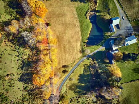 Scenic landscape with farm at autumn in Woodstock, Vermont, USA. Fall in New England. Aerial drone shot.